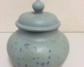 Speckled green and blue jar with lid