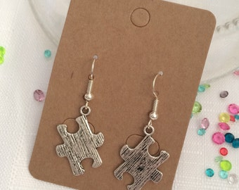 Silver tone puzzle earrings