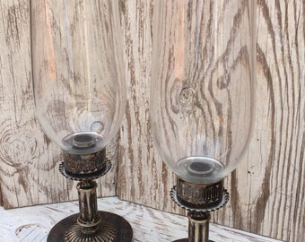A pair of Antique hurricane type candle holders