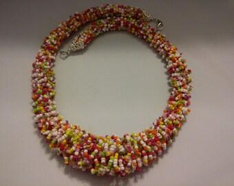 Multi-color beaded fur necklace.