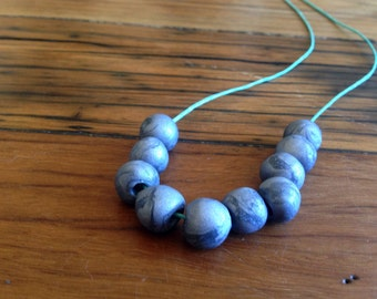 Silver swirl bead necklace, polymer clay