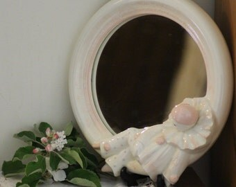PORCELAIN CLOWN MIRROR, lovely pastel pink colours.