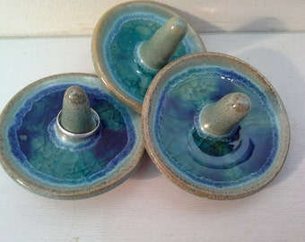 Ring holder.  Hand thrown ceramic with glass.  Can hold up to seven rings.
