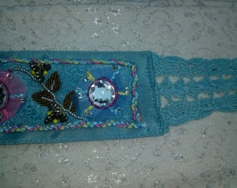 Belt sewn blue satin beads stones and hook hand
