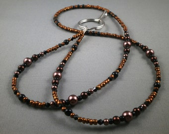 "black and brown beaded lanyard 28"" to 42"". Your choice of attachment: ID , key or eyeglass holder"