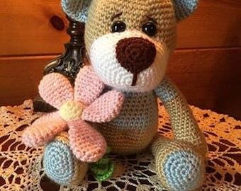 Crocheted tebby bear snuggle buddy