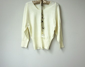 Vintage Korean Fashion, Italian Design, Long Sleeve V Neck Cream Sweater Top, with a Waist Cinching Hem and Elegant Detailing