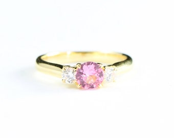Pink sapphire and diamond trilogy 3 stone engagement ring in 18 carat yellow gold for her handmade ring UK