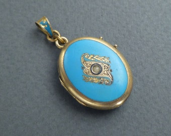Gold blue enamel locket with one small pearl