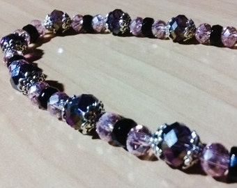 Beautiful crystal necklace in purple, black and pink. Sparkle!