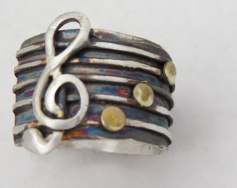 Ring sterling silver with copper or brass notes: music. Rusty. Adjustable