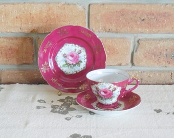 Ducal China crimson trio with rose motif footed teacup with saucer and side plate