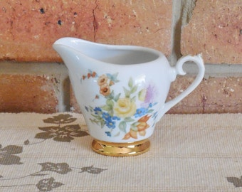 Hand painted and decorated porcelain creamer floral design 24K gilt 1960s