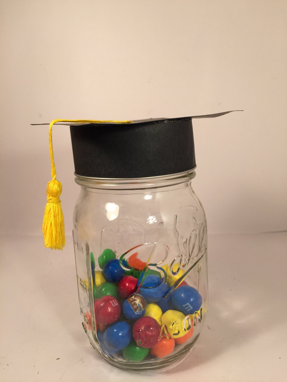 mason jars with graduation caps