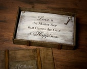 """Decorative wooden board displaying the saying """"Love is the master key ..."""""""