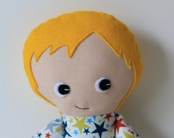 Boy rag doll with blond wool felt hair, blue shorts and star top.