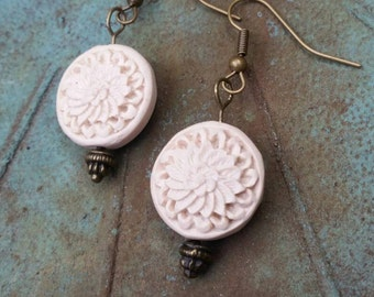 Dangle earrings with cream colored flower beads