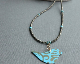 Bird Pendant Pyrite and Turquoise Beaded Necklace Teal and Golden Bronze Swirl Bird Statement Necklace Recycled Steel Pendant Blue and Gold