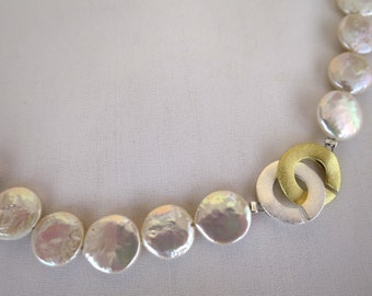 White flat pearl beaded necklace with closure in sterling silver.