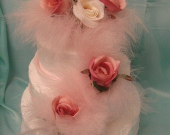 a  pink and ivory pink rose bud baby pink feather wedding cake topper set