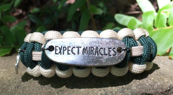 """Inspirational Paracord Bracelet,3 charms saying """"Expect Miracles"""" ,""""Be"""" and """"Faith"""" , with a nautical feel"""