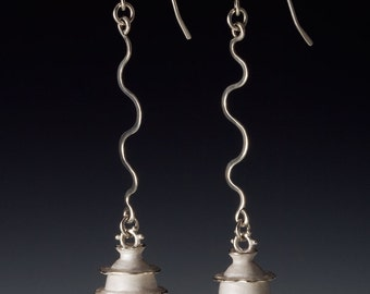 White Silver Abstract Beads Dangle from Expressive Silver Ear Wires