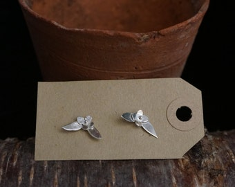 Tiny silver flower and leaf stud earrings