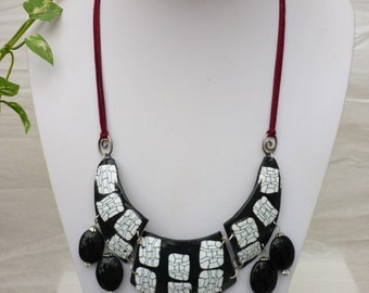 Necklace black torque with  fine black and white graphics