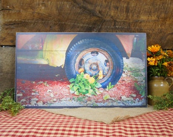 Rusty Truck with Flower at the Wheel Base Wood Slat Pallet Sign..Motivational Inspritational Rustic style country photo