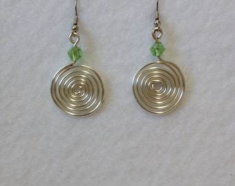 Earrings - Silver coiled with green Swarovski crystal