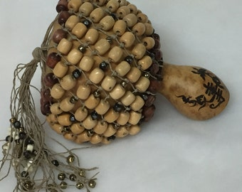 Shekere Bells is a home grown Gourd crafted into a rich sounding musical instrument. A perfect gift for any musician !