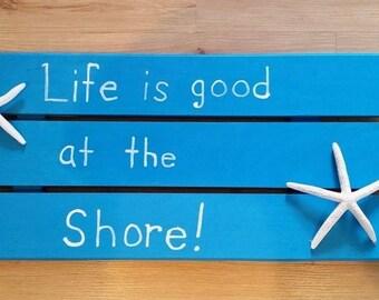 Wooden coastal wall sign