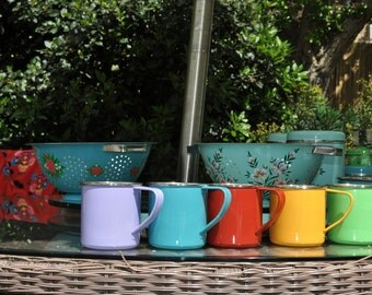 Set of four block coloured mugs