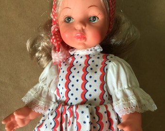 Plastic Doll with Red and White Dress Eastern European Doll