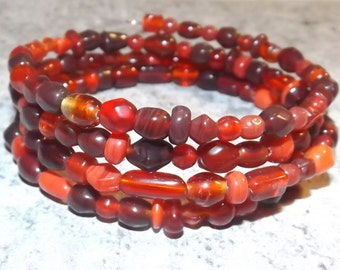 Bracelet of glass beads on memory wire, red tone, 4 rows