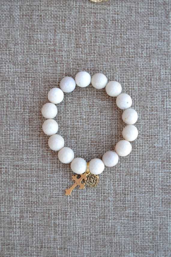 Faceted Cream Colored Stretch Bracelet with Cross Charms