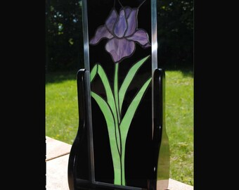 Stained glass Iris in stand.