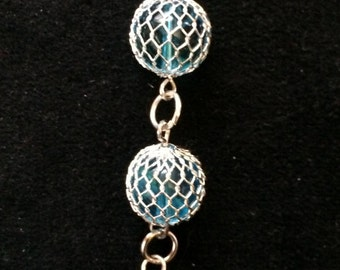 Wire-wrapped glass beads in turquoise