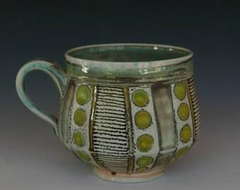 Soda fired copper green porcelain mug