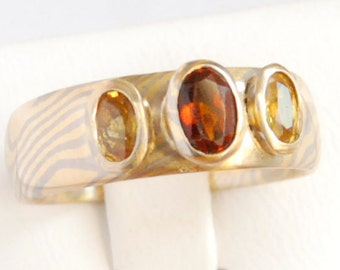 mokume gane ring with sapphire