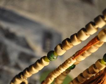 Tibetan mala - 108 pearls - bones and beads of glass, metered