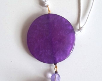 Necklace with purple pendant