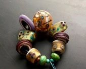 "Lampwork glass bead set handmade jewelry making supply by Lori Lochner "" butter and plum southwest rustic hollow statement necklace set """