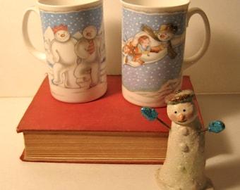 Three items,  Royal Doulton mugs , and a snowman , Raymond Briggs, Walking in the Air , coffee , tea hot chocolate mugs, The Snowman mugs,