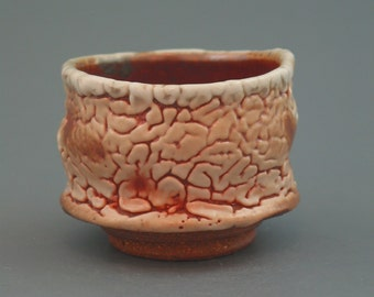 Teacup, wood-fired iron rich stoneware with crawling shino and natural ash glazes