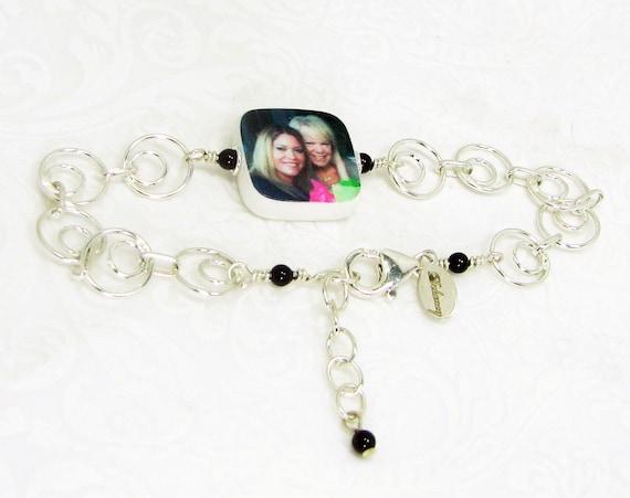 A charm bracelet with a custom, two-sided photo charm - C5RB5