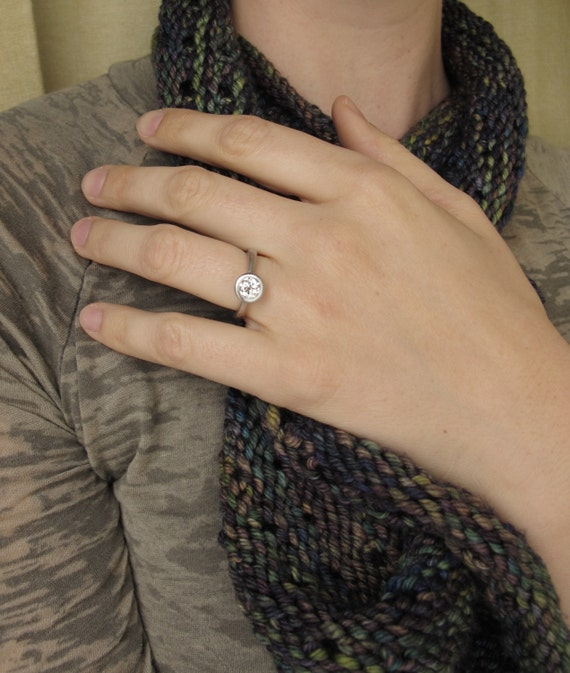 Platinum engagement ring, diamond solitaire with a tapered band,  open bezel peekaboo style setting, GIA certified diamond