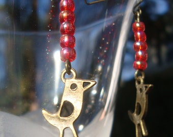 stylized brass bird on red AB stack earrings