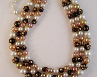 1950s triple strand glass bead choker necklace. Shades of brown and peach and pearls. Made in Japan.