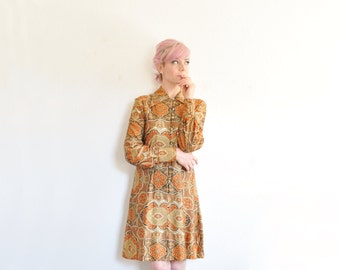 1970 gold trapestry dress . long sleeve mini shift .small.medium .sale